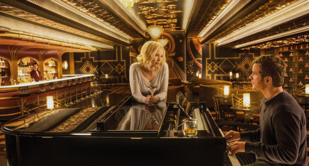 """Jennifer Lawrence, center, Chris Pratt, right, and Michael Sheen, left, in """"Passengers."""""""