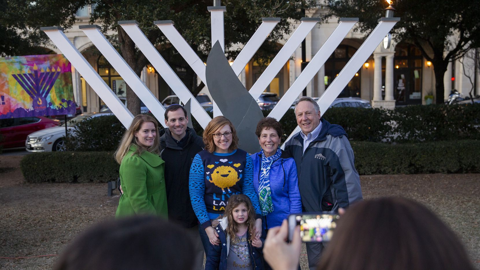 Families take a photo at the Chabad of Frisco's 2019 menorah lighting. This year's event, honoring health workers, includes COVID-19 precautions such as social distancing.