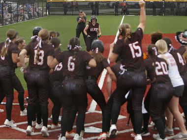 Aledo outfielder Marissa Powell (11) received quite the reception at home plate after hitting a three-run home run during the top of the fourth inning of play against Georgetown. The two teams played their UIL 5A state softball semifinal game at Leander Glenn High School in Leander on June 4, 2021.