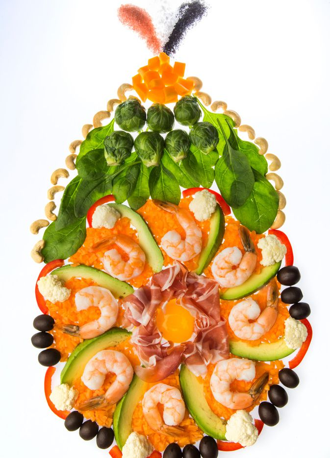 Various foods that are part of the Whole 30 diet, including salt, butternut squash, cashews, Brussels sprouts, spinach, red pepper, black olives, cauliflower, sweet potato, avocado, shrimp, prosciutto and eggs.