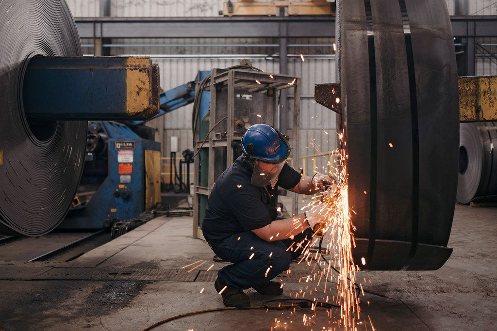 A worker grinds down imperfections in a roll of raw steel at the Borusan Mannesmann plant in Baytown, where steel manufactured and shipped in from Turkey is finished. The company is one of many in Texas seeking exemptions from the Trump administration on steel and aluminum tariffs.