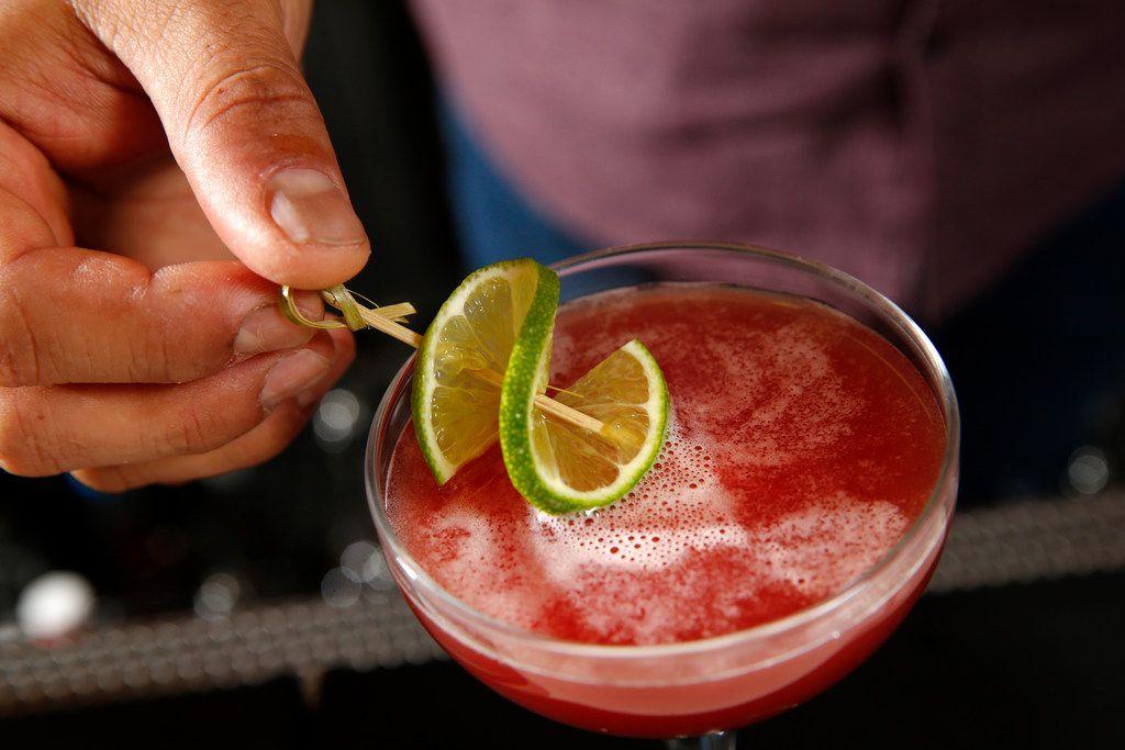 "Bar manager Ravinder ""Ravi"" Singh puts a slice of lime on the Agave Gimlet at Jalisco Norte in Dallas."