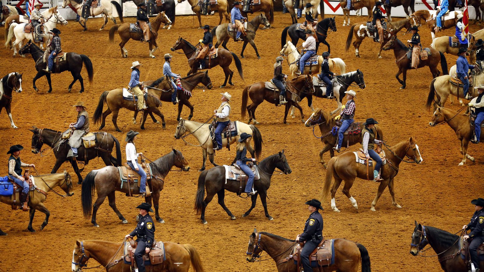 The grand entry kicks off the Professional Rodeo Cowboys Association rodeo at the Fort Worth Stock Show and Rodeo.