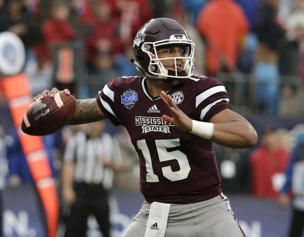 """FILE - In this Dec. 30, 2015, file photo, Mississippi State quarterback Dak Prescott (15) looks to pass against North Carolina State during the Belk Bowl NCAA college football game in Charlotte, N.C. Former Mississippi State quarterback and NFL draft prospect Prescott was arrested and charged with driving under the influence early Saturday morning, March 12, 2016. The Starkville Police Department confirmed Prescott's arrest on Twitter late Saturday night. The post said he was arrested around 12:45 a.m. and that there is """"no further information from SPD in this incident."""" (AP Photo/Chuck Burton, File)"""