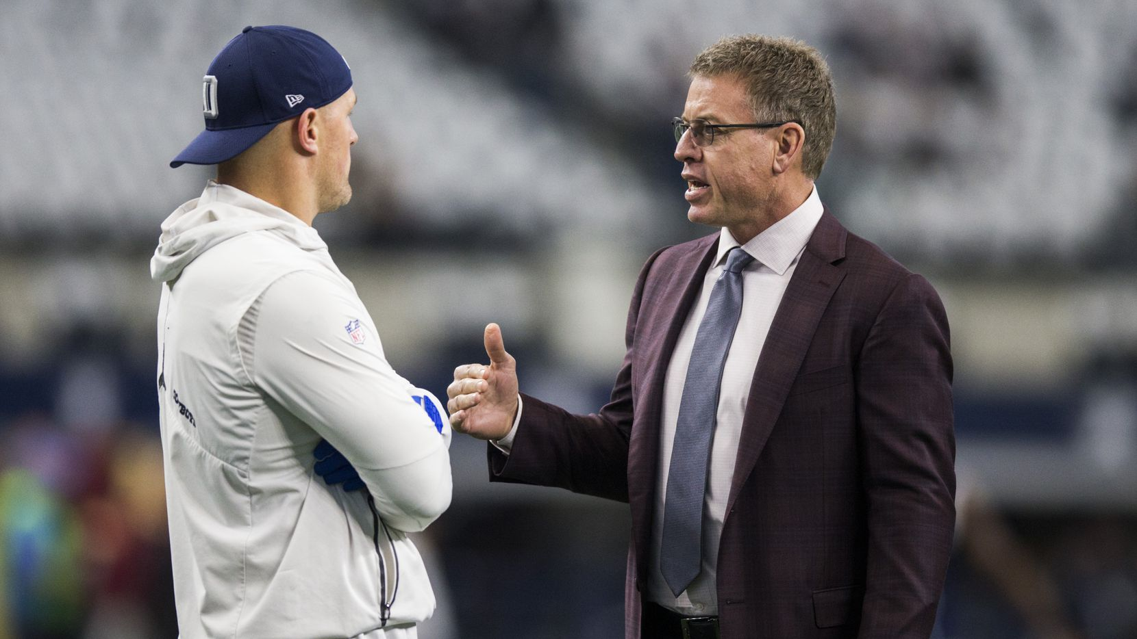 Dallas Cowboys tight end Jason Witten (82) talks with sports commentator and former Dallas Cowboys quarterback Troy Aikman before an NFL game between the Dallas Cowboys and the Washington Redskins on Sunday, December 29, 2019 at AT&T Stadium in Arlington, Texas.