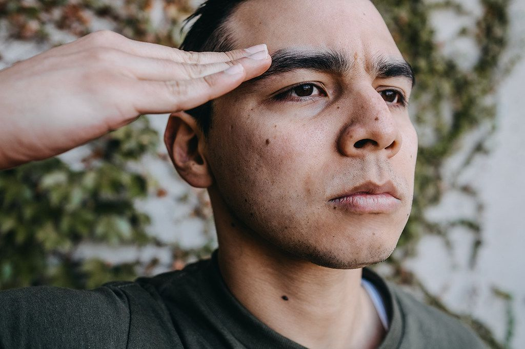 Christopher Llewn Ramirez performs in Elliot, A Soldier's Fugue, presented by WaterTower Theatre in Addison through Feb. 18, 2018.