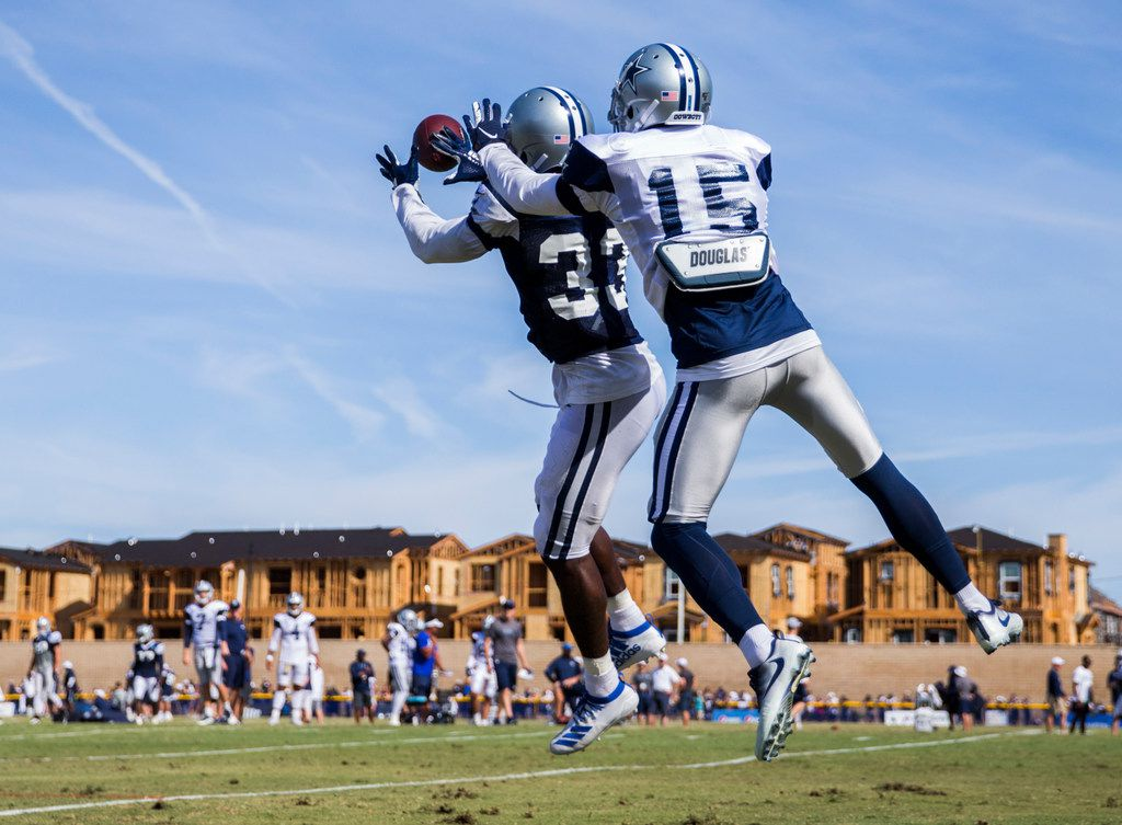 Dallas Cowboys cornerback Michael Jackson (33) intercepts a pass intended for wide receiver Devin Smith (15) during an afternoon practice at training camp in Oxnard, California on Saturday, August 3, 2019. (Ashley Landis/The Dallas Morning News)