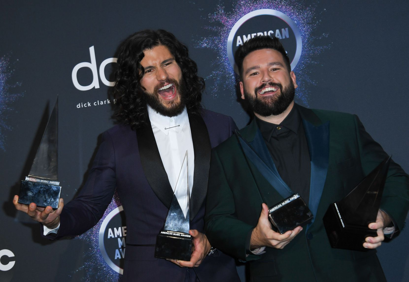 Dan Smyers and Shay Mooney of the musical duo Dan + Shay posed with their awards in the press room during the 2019 American Music Awards at the Microsoft Theatre in Los Angeles on Nov. 24, 2019.