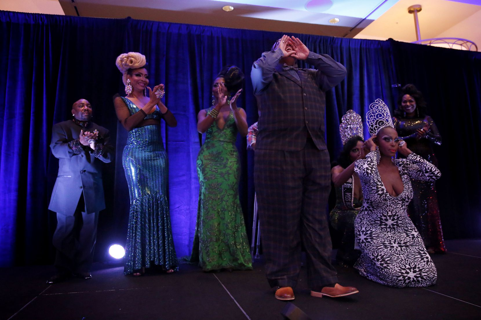 Trenton Johnson yells to the crowd upon winning the Mr. Black Trans International title in the Mr. and Miss Black Trans International Pageant at the Dallas/Addison Marriott Quorum by the Galleria in Dallas on Thursday, April 27, 2017.