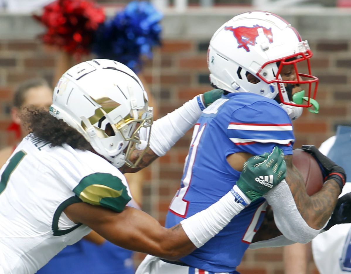 SMU receiver Reggie Roberson, Jr (21), right, scores a receiving touchdown as South Florida safety Matthew Hill (1) pursues defensively during first quarter action. SMU defeated South Florida 41-17. The two teams played their NCAA football game at SMU's Ford Stadium in Dallas on October 2, 2021. (Steve Hamm/ Special Contributor)