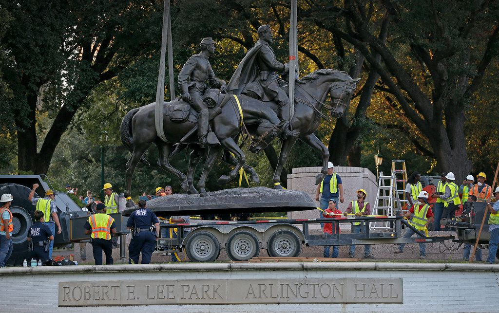 The Robert E. Lee statue is put in the back of a trailer truck at Robert E. Lee Park in Dallas, Thursday, Sept. 14, 2017. Crews arranged by Dallas officials removed the statue from its pedestal Thursday and carted it away from the park. (Jae S. Lee/The Dallas Morning News via AP)