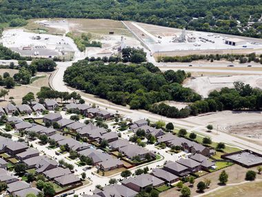 McKinney Greens subdivision sits on the opposite side of McDonald Street near CowTown Redi-Mix and Martin Marietta concrete plants in McKinney on Aug. 23, 2019.
