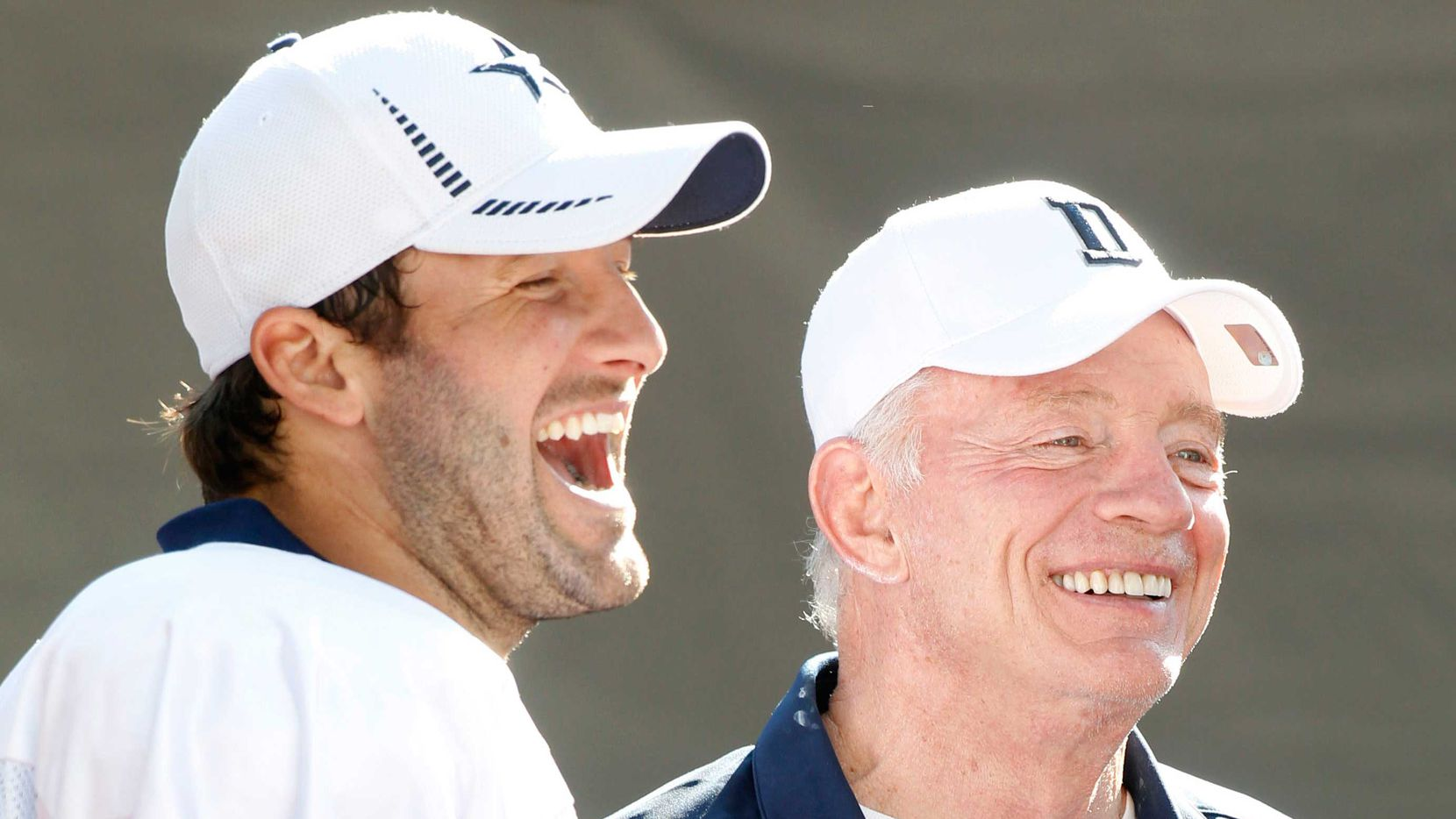 Dallas Cowboys quarterback Tony Romo (9) and owner Jerry Jones laugh after their afternoon practice at training camp in Oxnard, CA, on Wednesday, August 15, 2012.