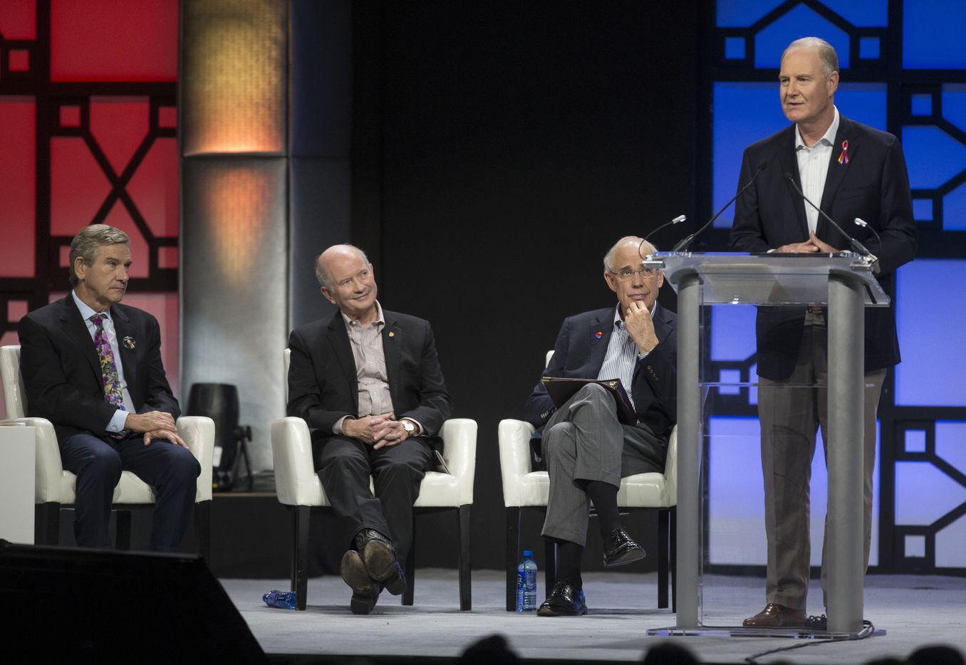 Southwest Airlines Chairman and CEO Gary Kelly, right, speaks as Presiding Director Bill Cunningham, second from right, Retired United States Air Force General Duncan McNabb (2nd left), and Craig Hall (far left) listen during a celebration of life event for Southwest Airlines Co-Founder Herb Kelleher on Tuesday, Jan. 22, 2019 at the Kay Bailey Hutchison Convention Center in Dallas.