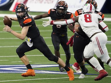 Aledo quarterback Brayden Fowler-Nicolosi (16) gets past Crosby defensive lineman Jeremiah Isaac (8) during the first half of the Class 5A Division II state football championship game at AT&T Stadium on Friday, Jan. 15, 2021, in Arlington. (Smiley N. Pool/The Dallas Morning News)