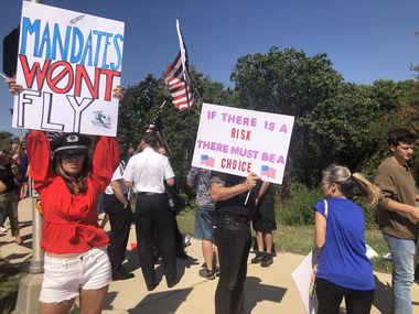A group of about 250 American Airlines employees and supporters rally outside American Airlines headquarters in Fort Worth on Thursday, Oct. 7, 2021. The group was protesting vaccine mandates for employees after the company said any worker that is not fully vaccinated would be fired.