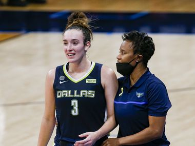 Dallas Wings guard Marina Mabrey (3) talks to coach Vickie Johnson on the sideline during the second quarter against the Los Angeles Sparks at College Park Center on Tuesday, June 1, 2021, in Arlington.