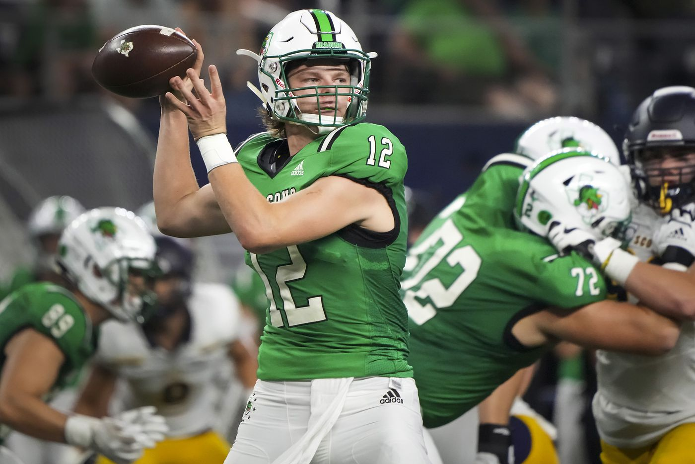 Southlake Carroll quarterback Kaden Anderson (12) throws a pass during the first half of a high school football game against Highland Park at AT&T Stadium on Thursday, Aug. 26, 2021, in Arlington.