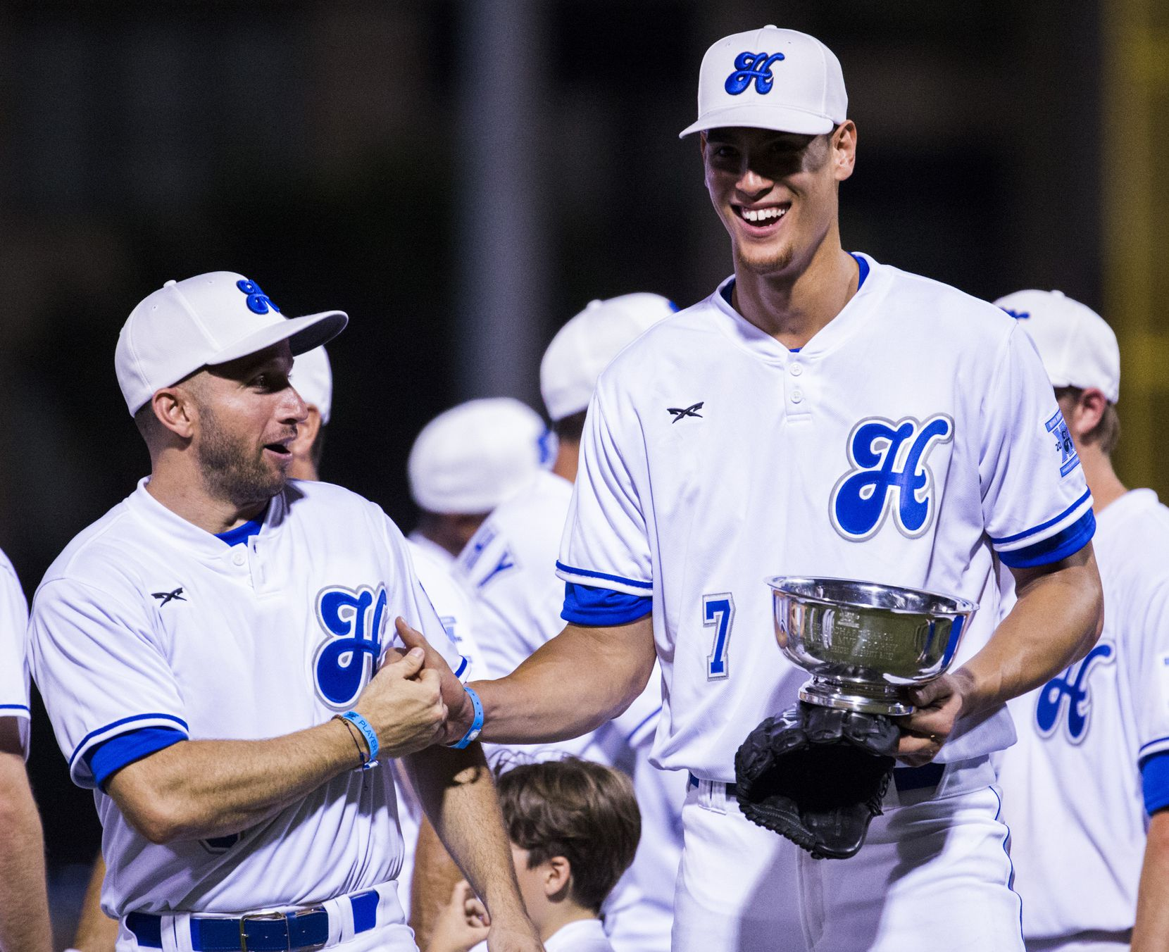 Dallas Mavericks forward Dwight Powell (7) celebrates being named the MVP with White Sox teammate Dallas Mavericks guard J.J. Barea (5) during Dirk Nowitzki's 2016 Heroes Celebrity Baseball Game on Friday, June 10, 2016 at Dr Pepper Ballpark in Frisco, Texas. The White Sox won 16-12 over the Blue Sox. (Ashley Landis/The Dallas Morning News)