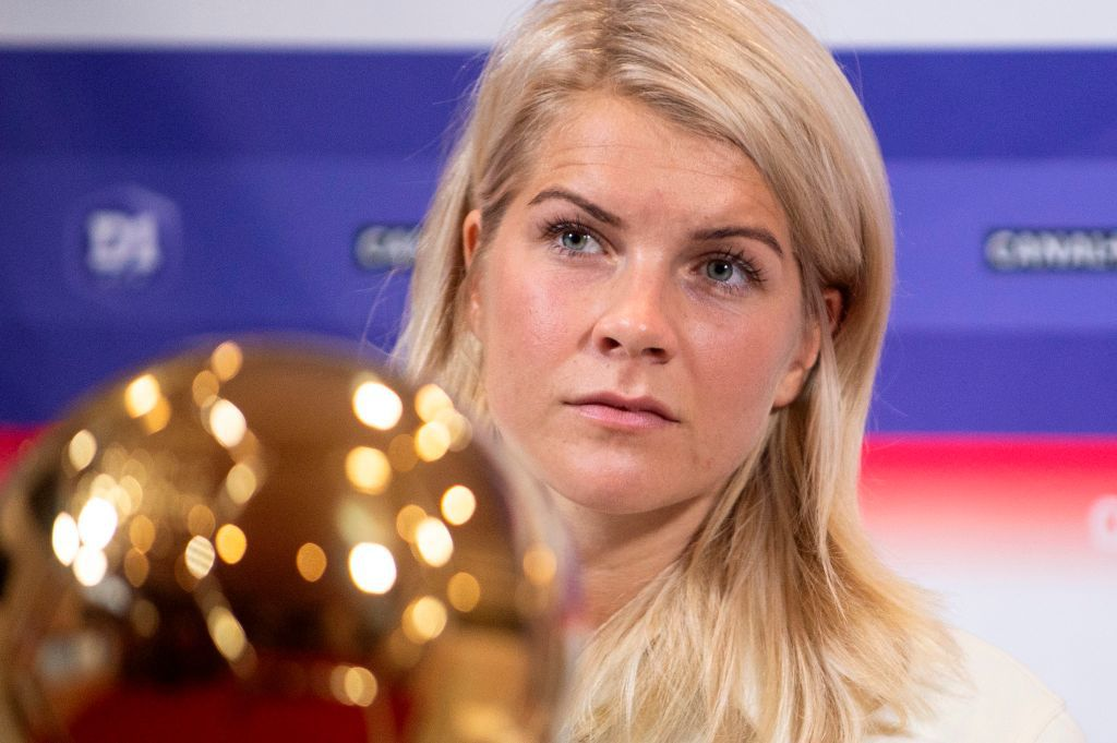 Lyon's Norwegian forward Ada Hegerberg, winner of 2018 Women's Ballon d'Or award for best player of the year, poses with the trophy during a press conference with Lyon's President at the Groupama training center in Lyon, central eastern France, on December 4, 2018. – Awarded the Golden Ball on December 3, Hegerberg is the first woman who won the price. (Photo by ROMAIN LAFABREGUE / AFP)        (Photo credit should read ROMAIN LAFABREGUE/AFP/Getty Images)