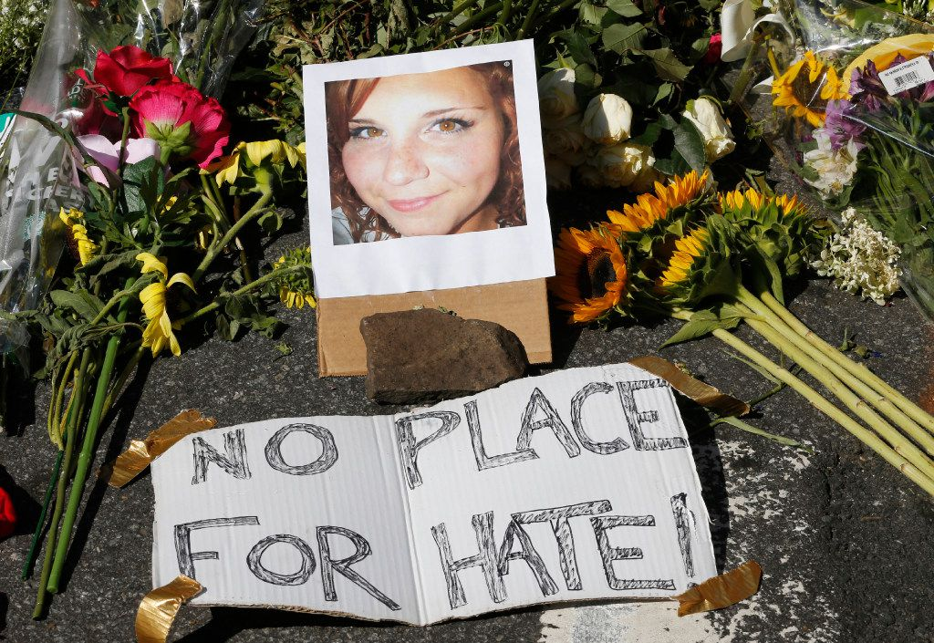 A makeshift memorial of flowers and a photo of Heather Heyer sits in Charlottesville, Va., on Aug. 13. Heyer was killed when a car rammed into a group of people who were protesting the presence of white supremacists who had gathered in the city for a rally.