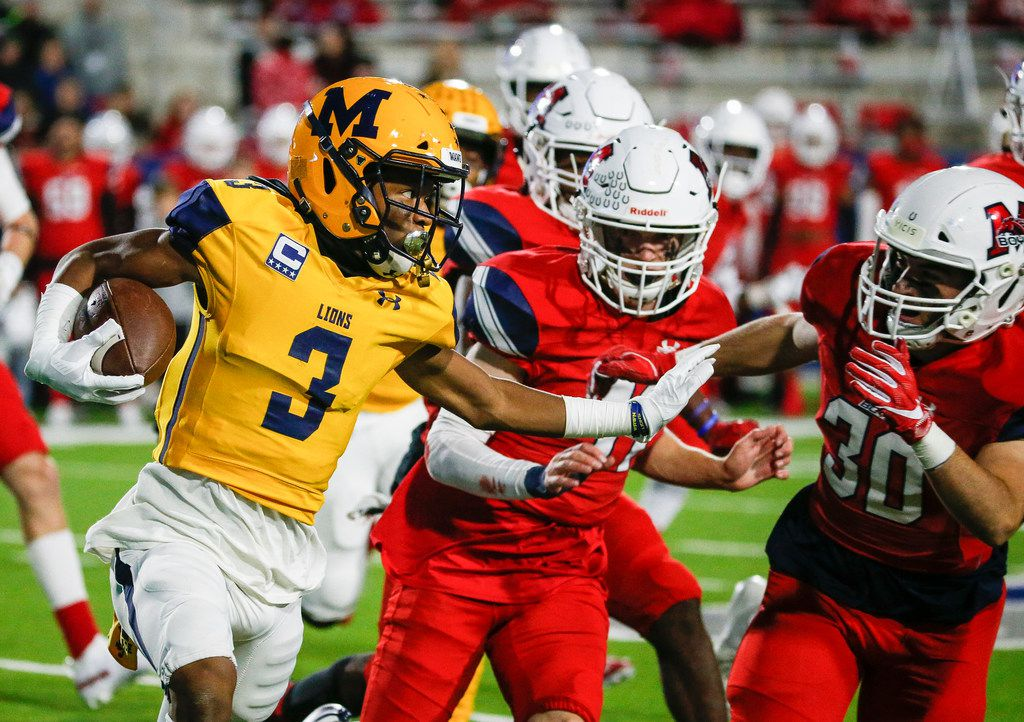 McKinney's Isaiah Wallace (3) looks for a lane around McKinney Boyd's Tim Longoria (30) during the second quarter of a high school football matchup between McKinney and McKinney Boyd at McKinney ISD Stadium on Friday, Nov. 8, 2019 in McKinney, Texas. (Ryan Michalesko/The Dallas Morning News)