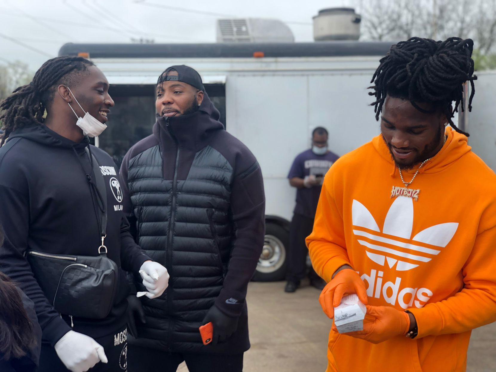 Cowboys defensive end DeMarcus Lawrence (left), defensive lineman Daniel Ross (center) and linebacker Jaylon Smith (right) oversaw an event where food vendors were commissioned to serve meals to local first responders at no charge at Seago Pantry in Dallas on March 22, 2020.