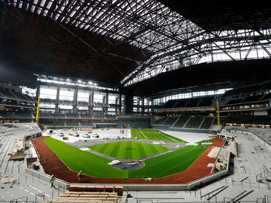 The artificial turf by Shaw Sports Turf and infield dirt are being installed at Globe Life Field under construction in Arlington, Tuesday, February 18, 2020. (Tom Fox/The Dallas Morning News)