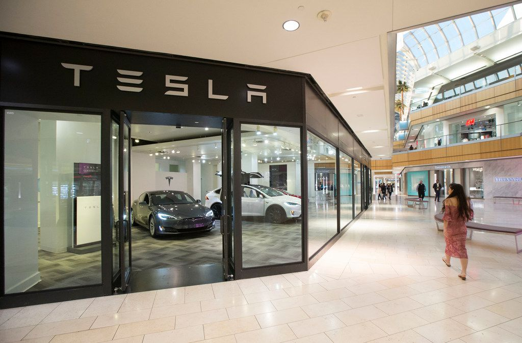 A woman walks past the Tesla showroom inside Galleria Dallas. The showroom is on the first floor of the mall across from Victoria's Secret.