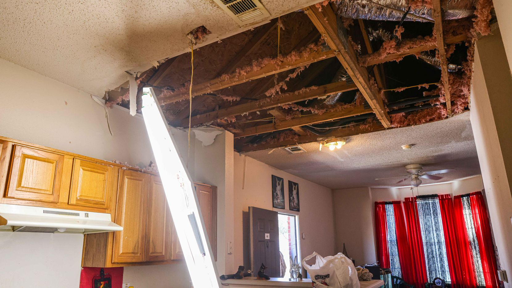 Lee Henderson's apartment at Westmoreland Heights in Dallas, where the kitchen ceiling collapsed due to water damage after the snow storm Uri hit Dallas this week. Irving is asking residents and business owners to report damage in an online survey.