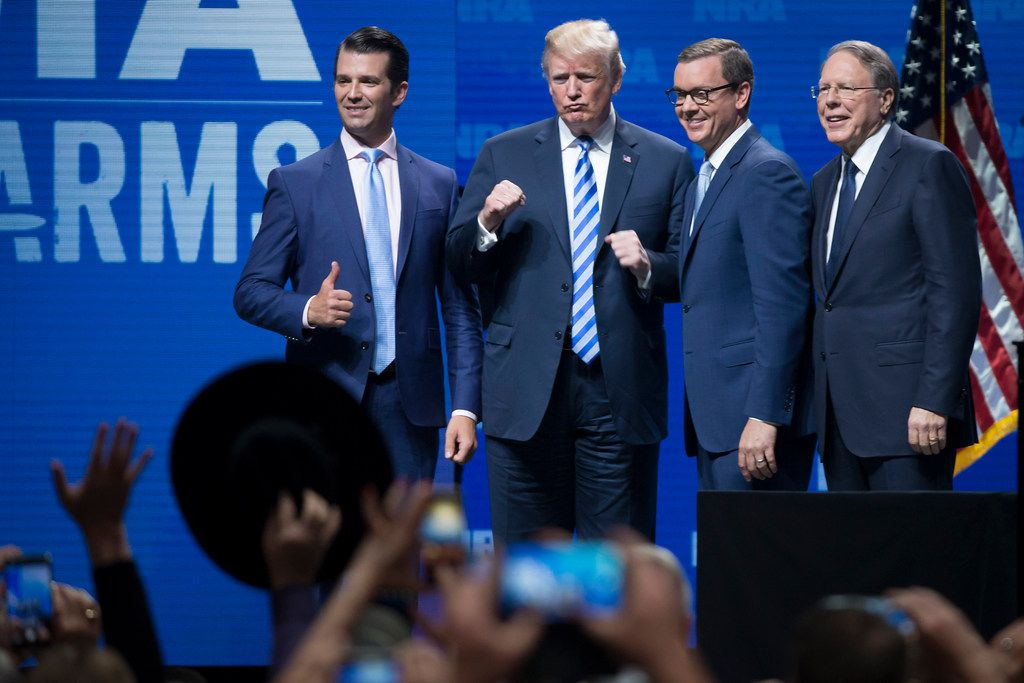 President Donald Trump stands with his son Donald Trump Jr. (left), NRA-ILA executive director Chris Cox, (second from right) and NRA chief executive Wayne Lapierre before addressing the NRA-ILA Leadership Forum at the Kay Bailey Hutchison Convention Center on Friday, May 4, 2018, in Dallas.