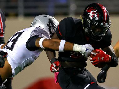 Denton Braswell running back Jaylon Burton (right) gets stopped for a short gain by Denton Guyer defensive back Marquan Pope (33) during the second half in a District 5-6A high school football game played at the C.H. Collins Complex on Friday, October 8, 2021, in Denton. (Steve Nurenberg/Special Contributor)