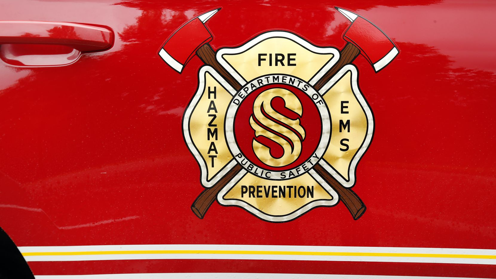 A Southlake Fire Department logo is pictured on a department vehicle in Southlake, Texas, Tuesday, June 23, 2020.