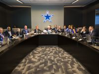 Dallas Cowboys Owner Jerry Jones, center, Head Coach Jason Garrett, center left, CEO and Executive Vice President Stephen Jones, center right, and other Cowboys executives wait to make their first round pick in the war room on Thursday, April 26, 2018 at The Star in Frisco, Texas.