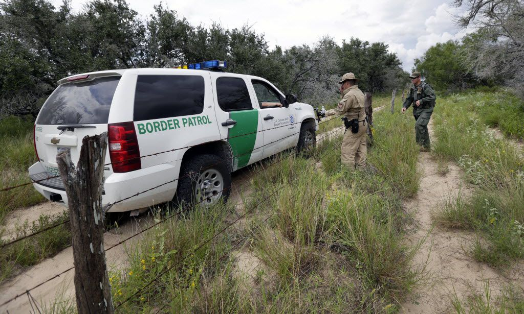 U.S. Customs and Border Protection agents confer as they patrol near McAllen in South Texas. (File Photo/The Associated Press)