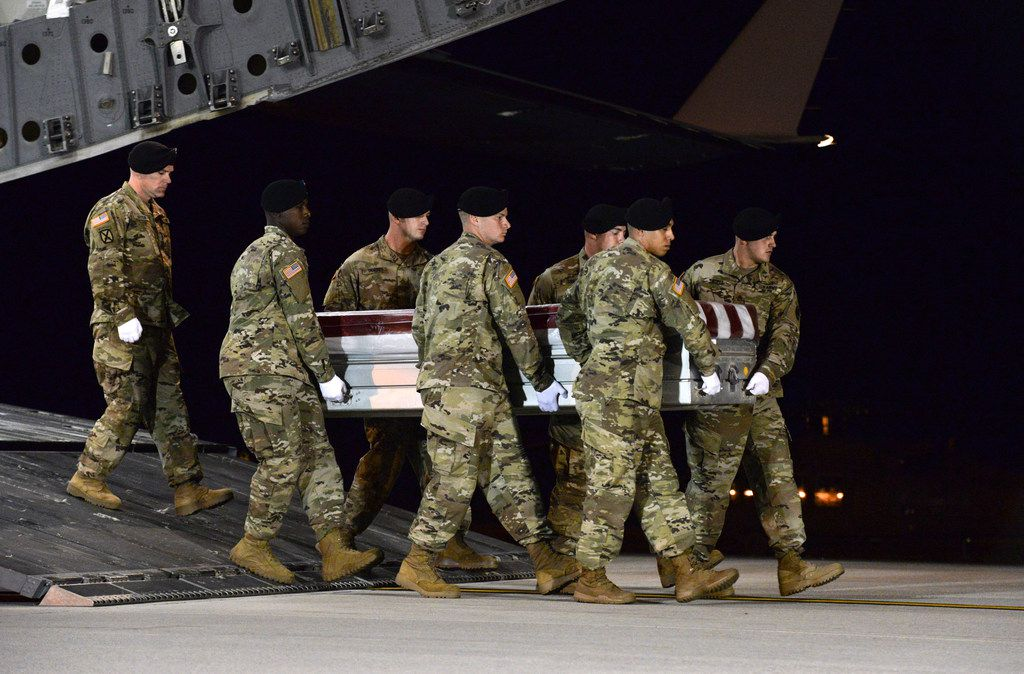 In a photo provided by the U.S. Air Force, the remains of Staff Sgt. Dustin Wright, one of four American soldiers killed in a firefight in Niger, is returned to Dover Air Force Base in Delaware, Oct. 5, 2017. Senior military officials said that a report will likely reveal that the American troops had deployed to a hostile area without adequately assessing the risk, and lacked ready access to medical support. (U.S. Air Force via The New York Times) -- FOR EDITORIAL USE ONLY --