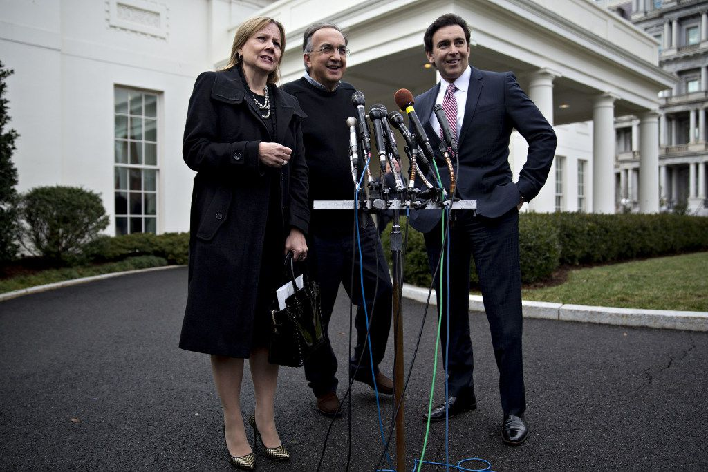 General Motors CEO Mary Barra, left, speaks with the media alongside Fiat Chrysler CEO Sergio Marchionne and Ford CEO Mark Fields after meeting Jan. 24 with President Donald Trump. (Andrew Harrer/Bloomberg)