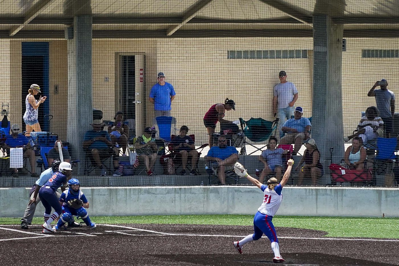 Fans watch a softball game between the Texas Glory 18U team (in white jerseys) and the American Freedom Gold Coleman 18U in the Triple Crown Texas State Tournament at Spirit Park on Monday, June 15, 2020, in Allen, Texas. (Smiley N. Pool/The Dallas Morning News)