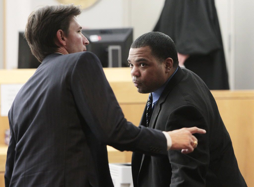 Phillip Hayes, left, one of the defense attorneys for Franklin Davis takes a break at the Frank Crowley Courts building on Tuesday, November 12, 2013. Davis is on trail for the shooting and killing of 16-year-old Shania Gray of Carrollton. He was found guilty today in Dallas.