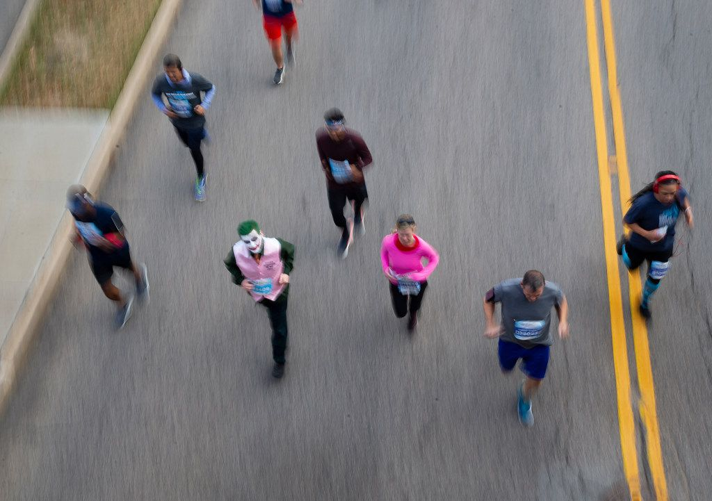 BMW Dallas Marathon runners race down Commerce Street on Dec. 15, 2019 in Dallas. (Juan Figueroa/The Dallas Morning News)