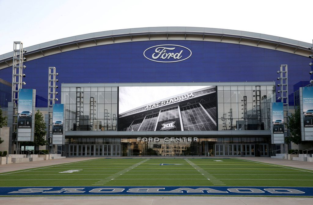 The Ford Center at The Star in Frisco on Tuesday July 17, 2018. Various videos are shown on the big screen over the field. In this photo an image of AT&T Stadium in Arlington, where the Cowboys play their games. The outdoor field is part of Tostitos Championship Plaza, foreground. (Vernon Bryant/The Dallas Morning News)