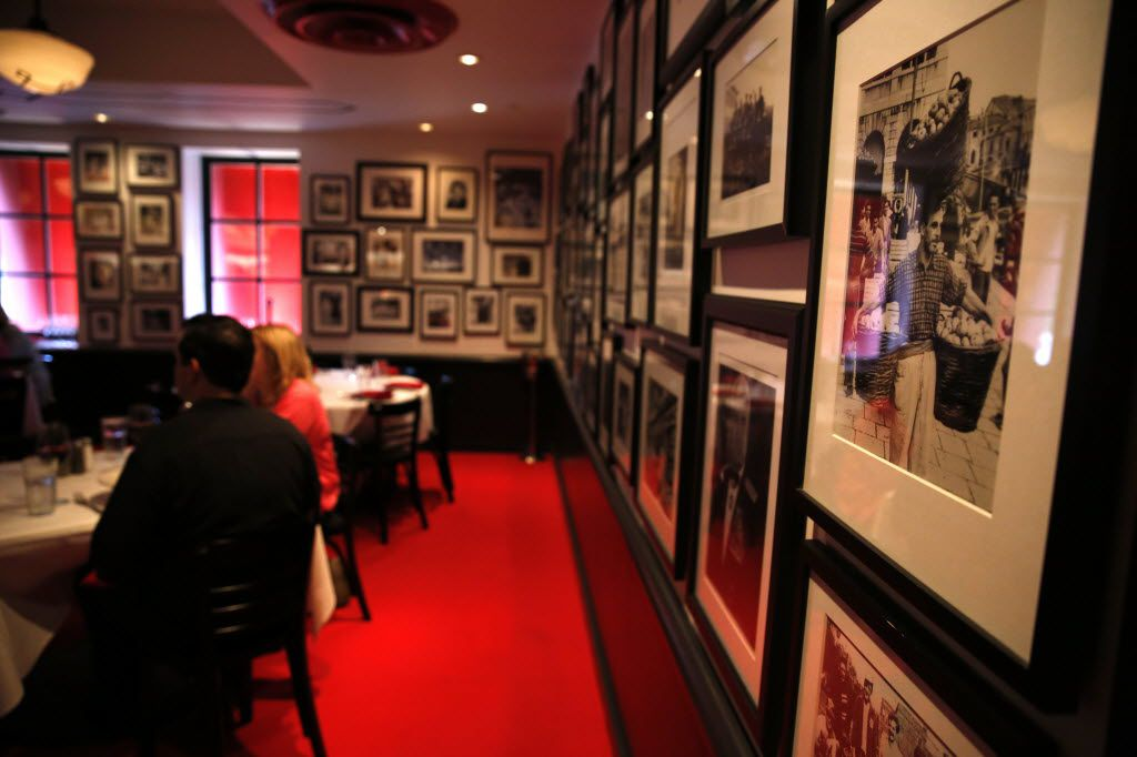 Photos of the owners' family and friends line the walls of Saint Rocco's