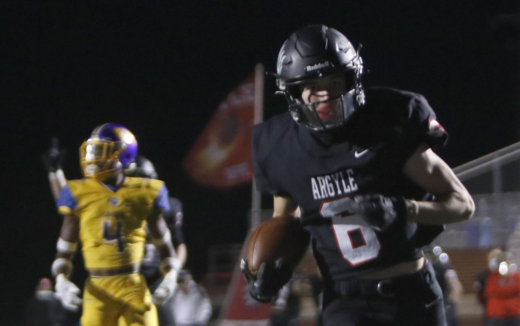 Argyle receiver Hayden Stewart (6) rambles into the end zone for a first quarter receiving touchdown in their game against Waco LaVega. The two teams played their Class 4A Division l Region ll semifinal football playoff game at Joshua's Owl Stadium in Joshua on November 27, 2020.