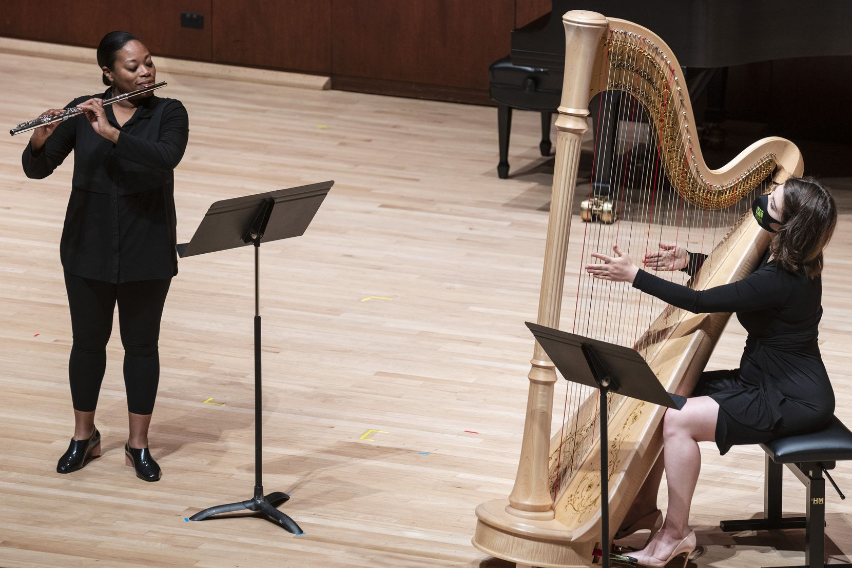 Flutist Ebonee Thomas and harpist Emily Levin perform 'Serenade No. 10,' for flute and harp, by Vincent Persichetti, at the Voices of Change concert on April 18 at Caruth Auditorium on the campus of Southern Methodist University in Dallas.