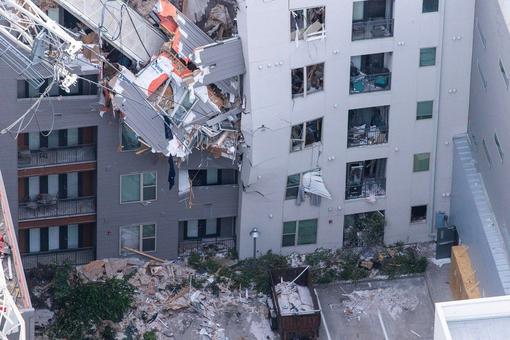 A crane sliced through the Elan City Lights apartments in June as a violent windstorm passed through Old East Dallas.