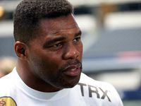 Former Cowboys player Herschel Walker talks with the media as the UFC hosts an open workout with welterweight champion Georges St-Pierre and No. 1 contender Johny Hendricks at AT&T Stadium Stadium in Arlington on Friday, August 2, 2013.