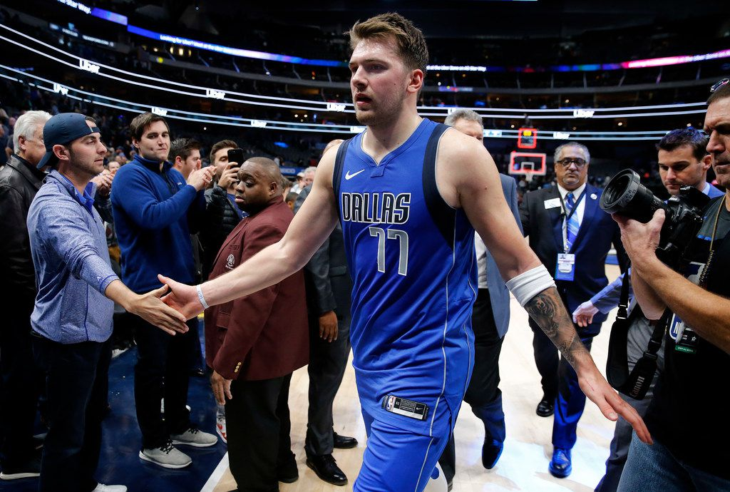 Dallas Mavericks forward Luka Doncic (77) is congratulated by fans after their win over the San Antonio Spurs at the American Airlines Center in Dallas, Monday, November 18, 2019. The Mavericks won, 117-110.