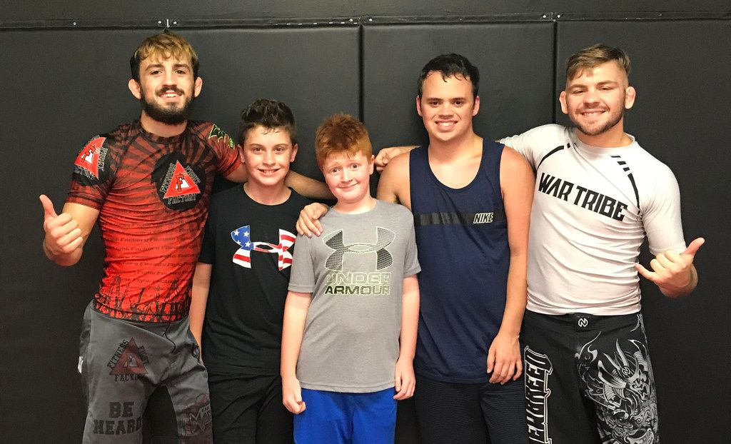 From left: Devin Miller; Trevor Meyer, Trent Meyer, Dylan Miller and Levi Mowles at Fitness Fight Factory in North Richland Hills, Texas. Devin, a mixed martial arts fighter, holds a free weekly special needs class for his brother Dylan and others with autism.