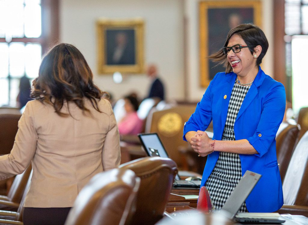 State Rep. Jessica González (right) chatted with Rep. Nicole Collier of Fort Worth on the House floor at the Capitol on May 27, 2019.