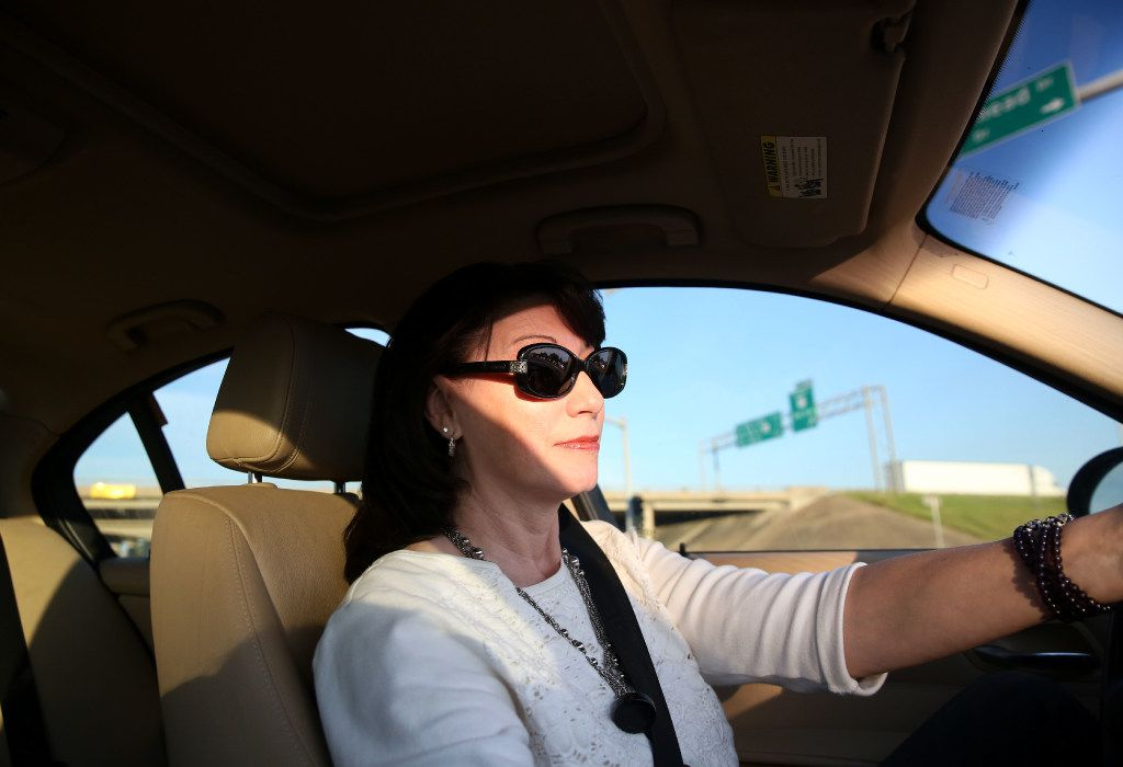 Dawn Humphrey drives into Waco on her way home from her Irving office. (Rose Baca/Staff Photographer)